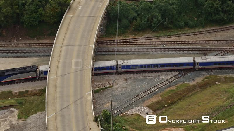 North Carolina Raleigh Aerial Panning around following moving train near Central Prison