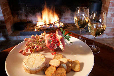 Cheese, bread, wine and open fire.
