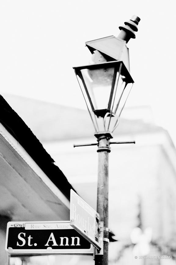 ST. ANN AND BOURBON STREET SIGN AND LAMP FRENCH QUARTER NEW ORLEANS LOUISIANA BLACK AND WHITE VERTICAL