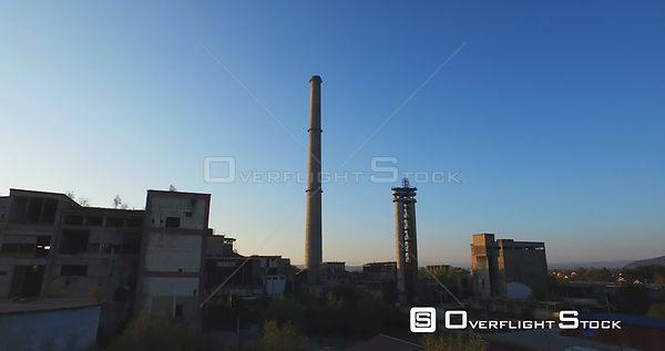 Aerial view of abandoned industrial buildings and chimney at sunset. Banja Luka, Bosnia and Herzegovina