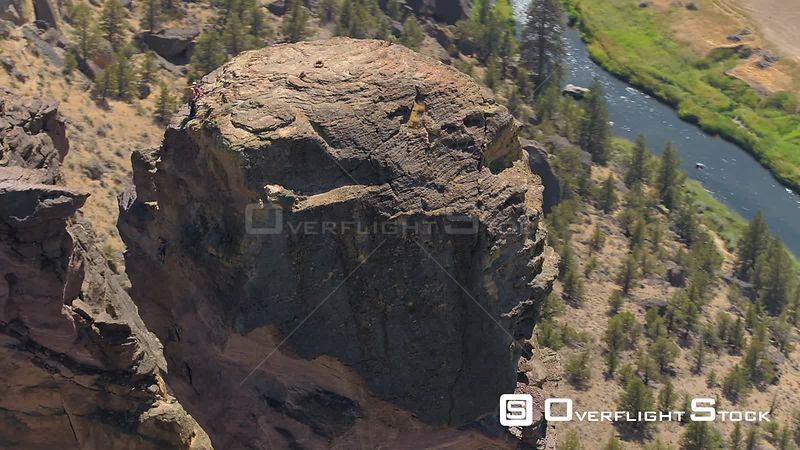 Oregon Aerial Birdseye closeup view flying low around Monkey Face at Smith Rock park
