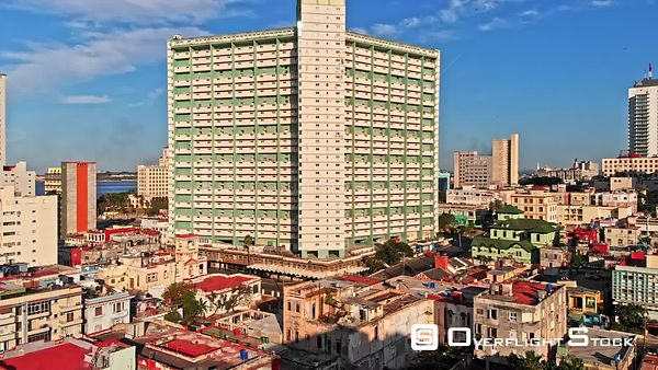 Cuba Havana Flying overtop tall apartment building to cityscape view