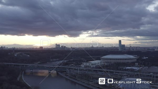 Late Sunset Backward Flight Over the Moscow River, With Luzniki Stadium. Moscow Russia Drone Video View