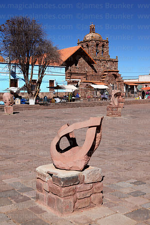 Modern art sculpture in main square and San Pedro church, Tiwanaku, La Paz Department, Bolivia