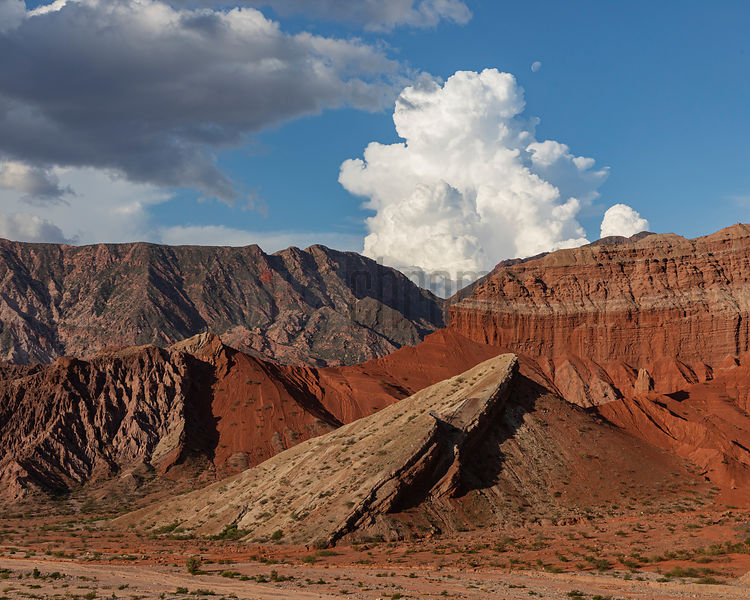 Weathered Sandstone Cliffs and Cumulus Clouds