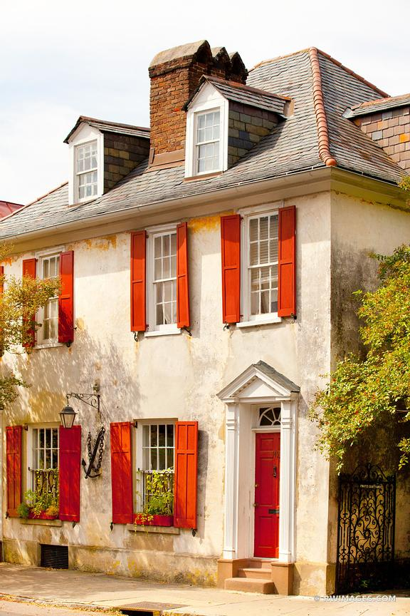HOUSE WITH RED WINDOW SHUTTERS CHARLESTON ARCHITECTURE CHARLESTON SOUTH CAROLINA COLOR VERTICAL