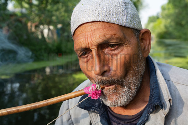 Kashmiri Man Smoking Hookah on Dal Lake