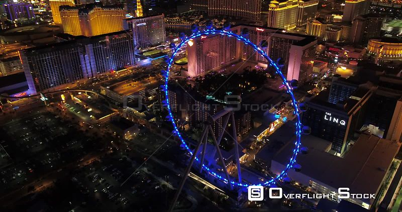 Las Vegas Aerial v40 Flying over and around High Roller ferris wheel at night 4/17