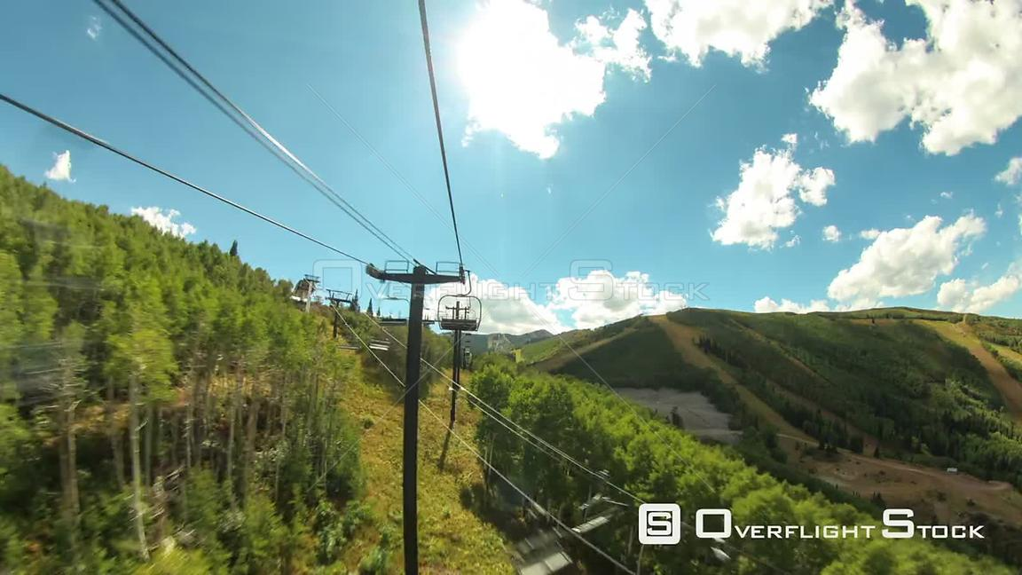 Ski lift ride time lapse up mountain in the summer.