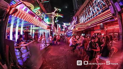 City pedestrian crowd time lapse of Soi Cowboy street in Bangkok Thailand