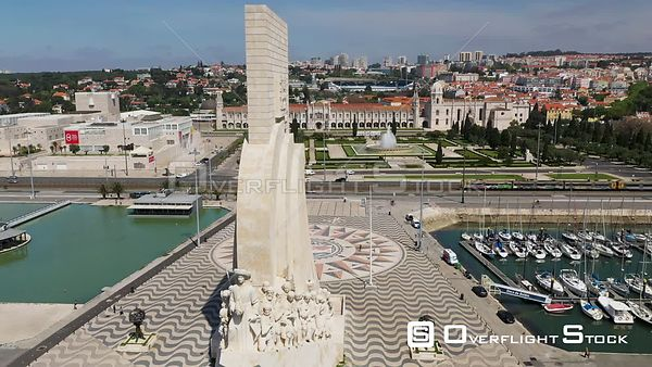 Aerial reverse descending of Monument to the Discoveries, in Belém, Lisbon, empty streets During Covid-19 Pandemic Portugal