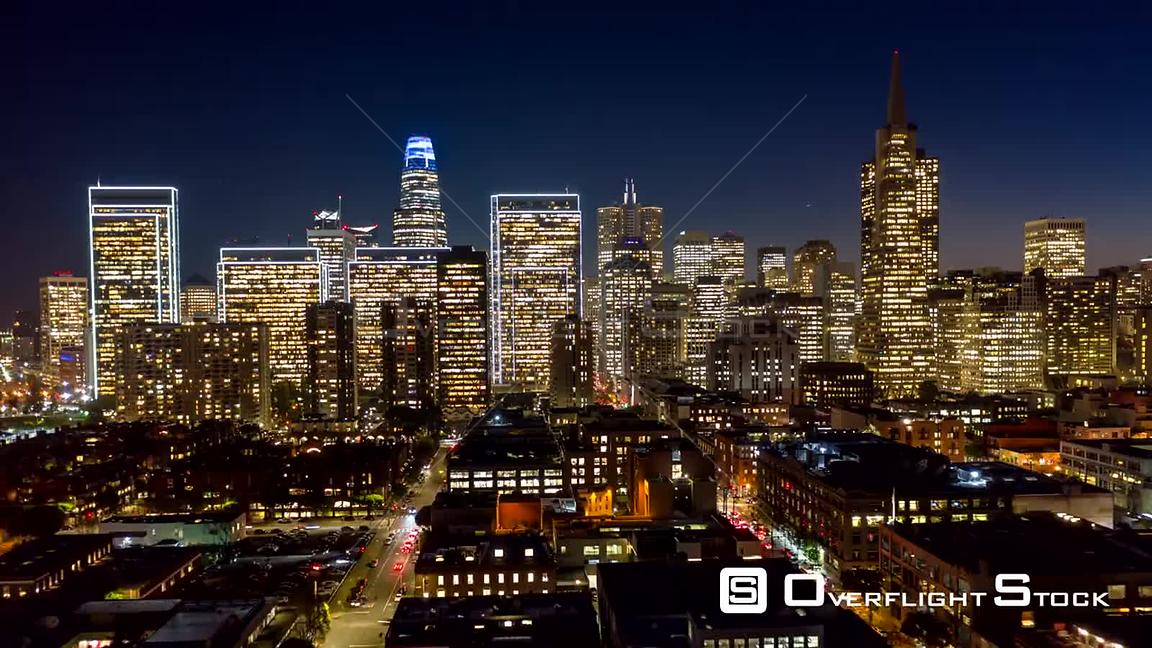 San Francisco Aerial Dusk to night hyperlapse following paths of Front & Battery streets from Financial District toward Embar...
