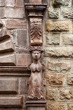 Detail of stone carving of armless female figure next to doorway of the Municipal Theatre, Cusco, Peru