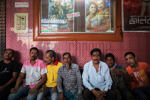 Men Sitting in the Lobby of a Movie Theatre in Old Dhaka