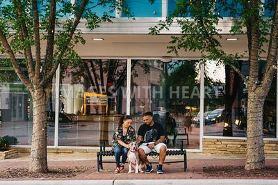 Pit Bull and Family Sitting on a Bench