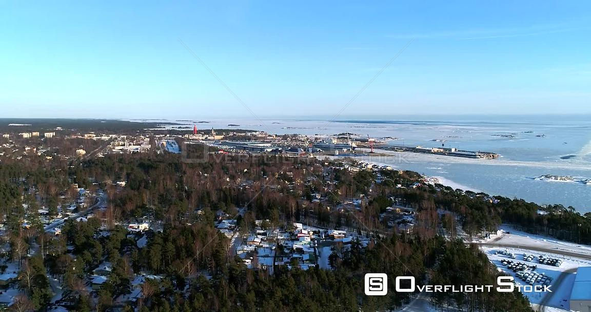 Frozen Cityscape, 4k Aerial Sideway View of a Icy Hanko City, Cold Sunny Winter Day, Tulliniemi, Uusimaa, Finland