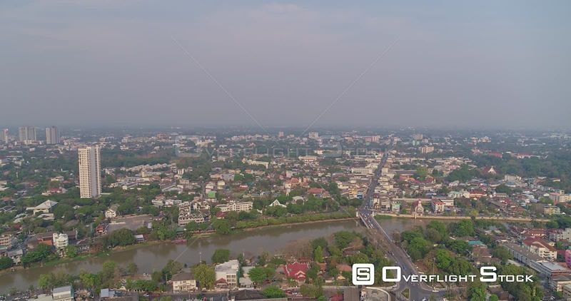 Chang Mai Thailand Aerial Ascending cityscape shot with water and road