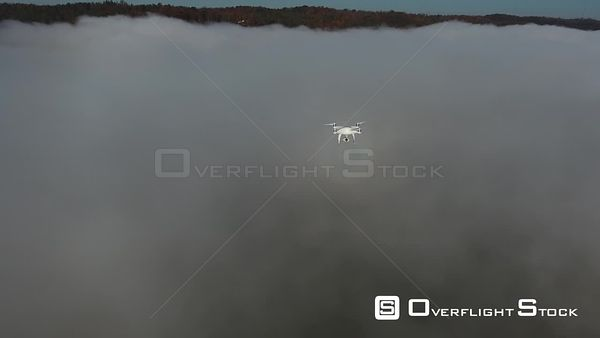 Drone in Flight Over Fog Layer