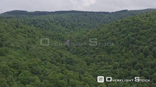 North Carolina Mountains Slow panning distant view of East Fork' Blue Ridge Upper Falls, following path of forest ravine