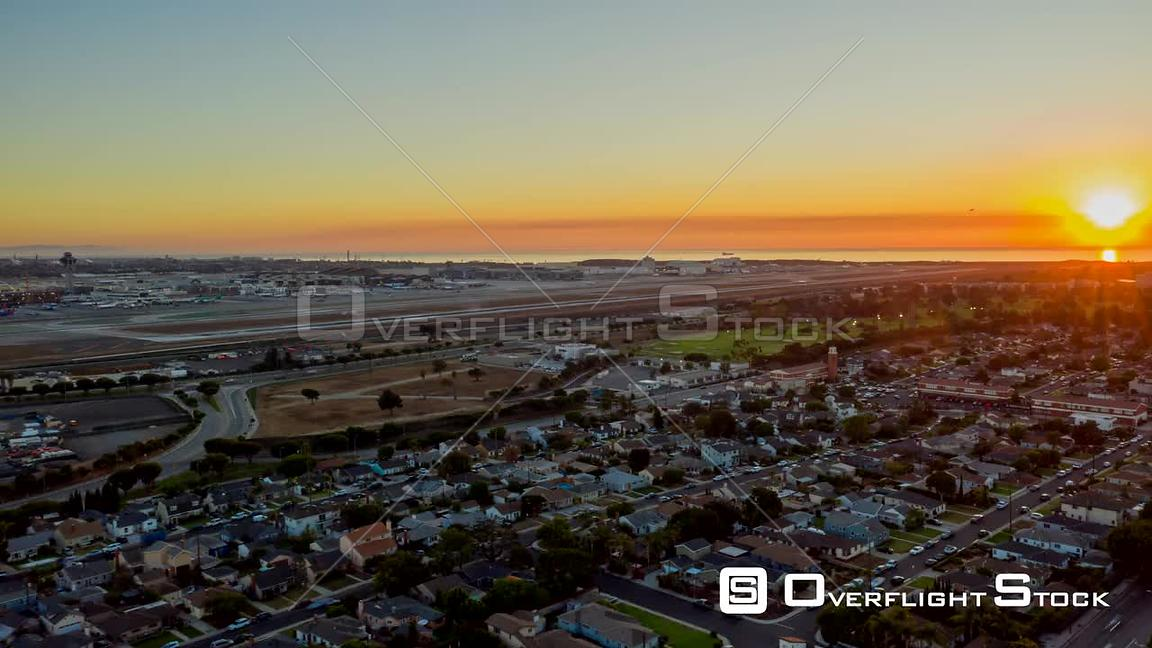 Los Angeles Hyperlapse of LAX runways and surrounding area cityscape with sun setting