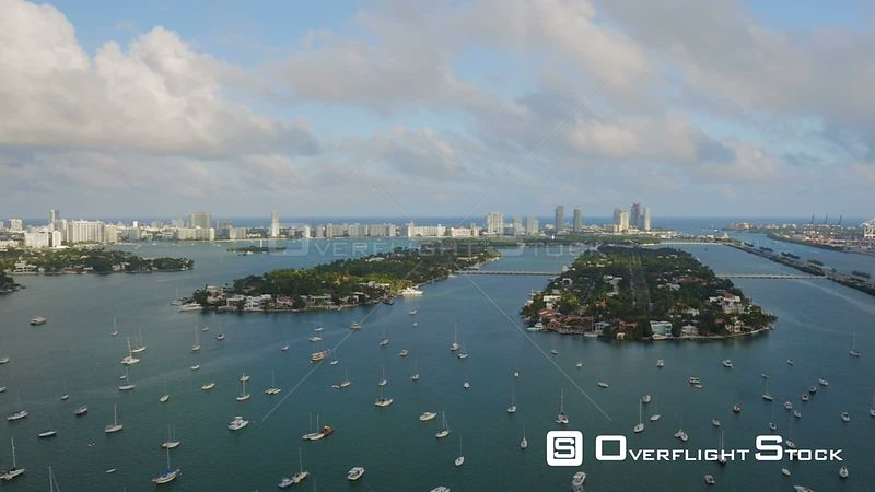 Miami Florida Flying over bay panning with south beach, islands, and shipyard views.