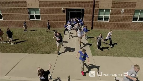 Elementary School Kids Running out of Class.