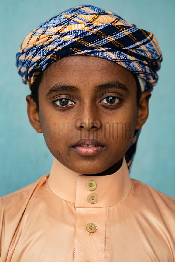 Portrait of a Young Boy at the Baitul Mukarram Mosque