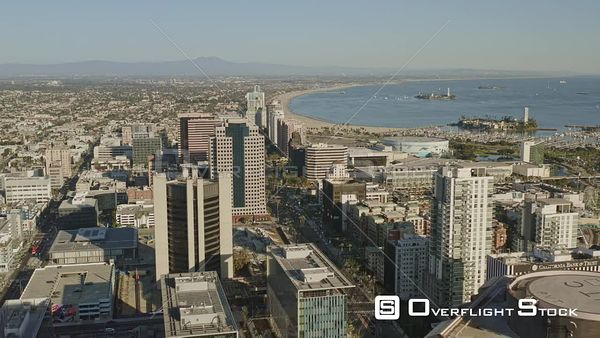 Long Beach CA Flying over, slightly descending over downtown cityscape near E Ocean Boulevard toward beach