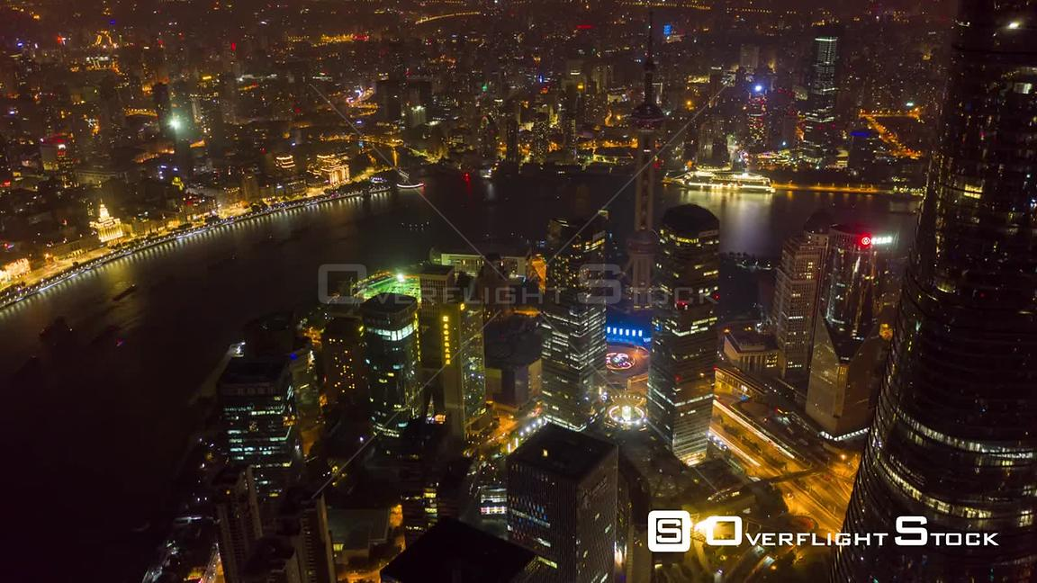 China Shanghai Aerial Hyperlapse birdseye night view of Huangpu riverfront flying over financial district