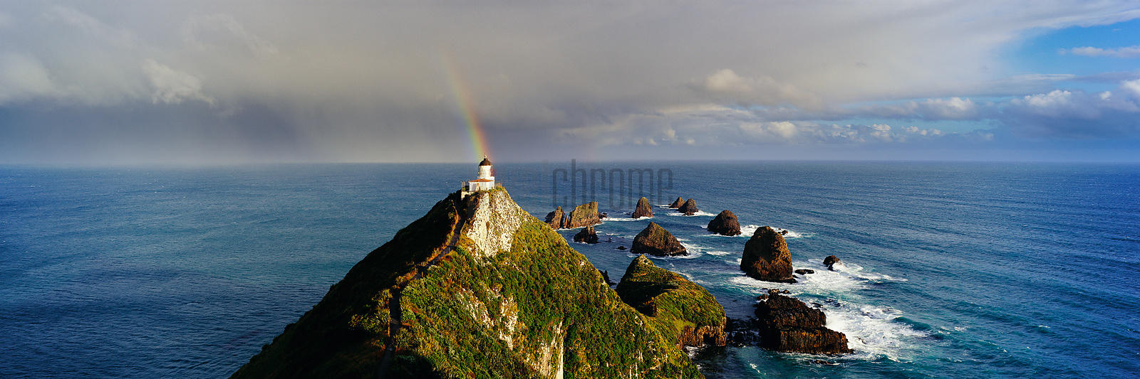 Nugget Point Lighthouse with Rainbow