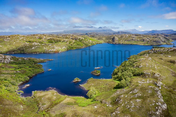 Aerial View of a Lochan and Mountains in the Assynt Region