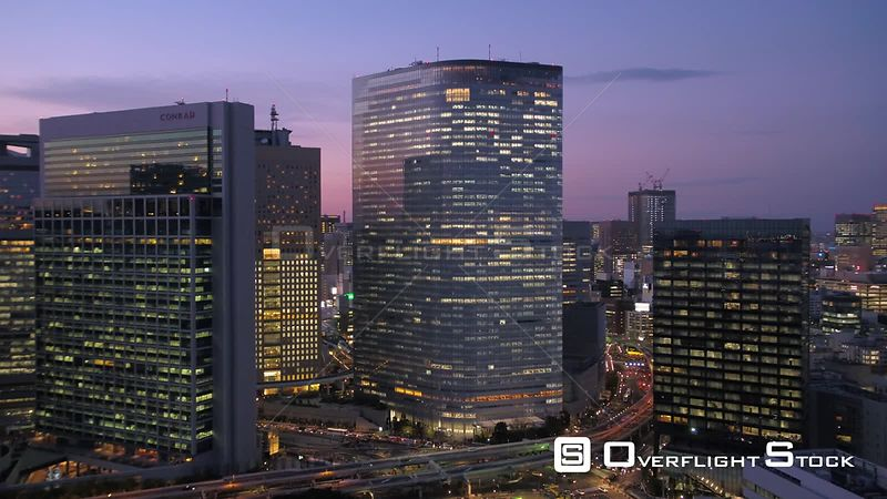 Japan Tokyo Aerial Flying over Shinjuku area panning downtown cityscape views sunset
