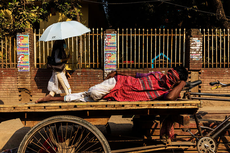 Bicycle Rickshaw Driver Resting