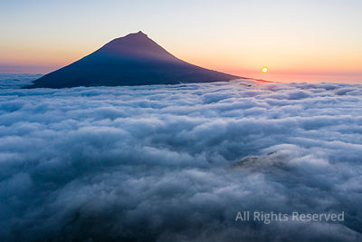 Aerial Image With Magical Sunset Over a Low Cloud Layer Covering Pico Island, With Ponta Do Pico (mount Pico), the Highest Mo...