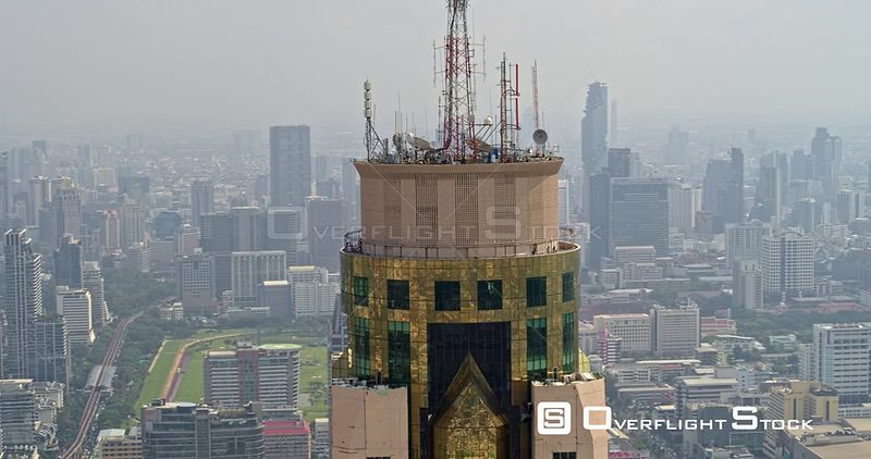 Thailand Bangkok Aerial Panoramic cityscape with tower rooftop and deck in foreground, panning left