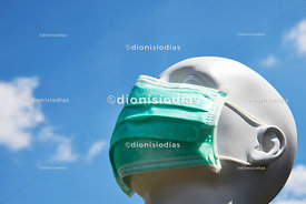Air borne contamination protection mask dressed in a mannequin, looking up at the sky