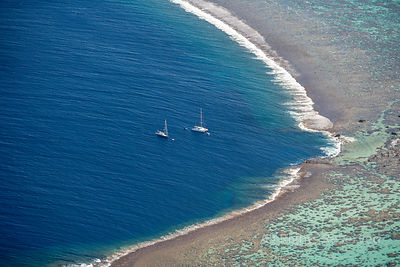 Sailboats off Tetiaroa Atoll Tropical Islands of French Polynesia