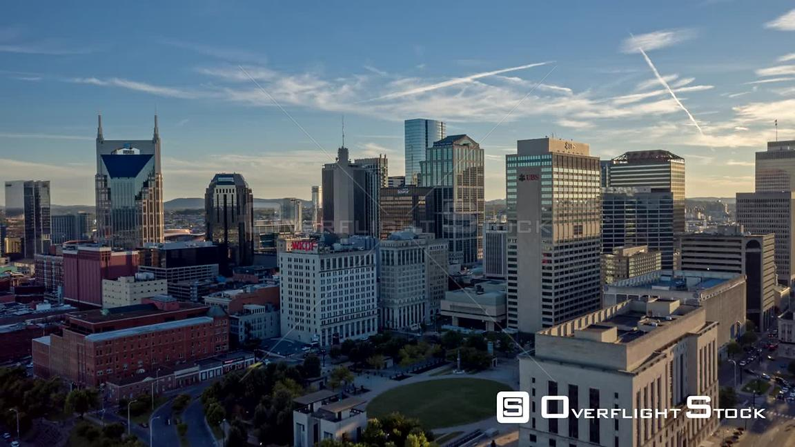 Tennessee Nashville Aerial Cityscape hyperlapse flying low over river and over downtown buildings