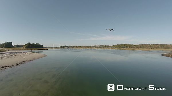 Low flying aerial over estuaries and beach in Maine.
