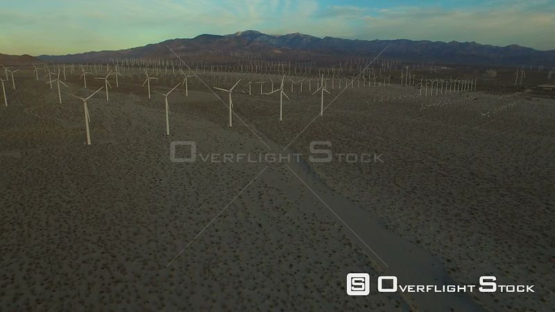 California USA  Flying low over large wind turbines.