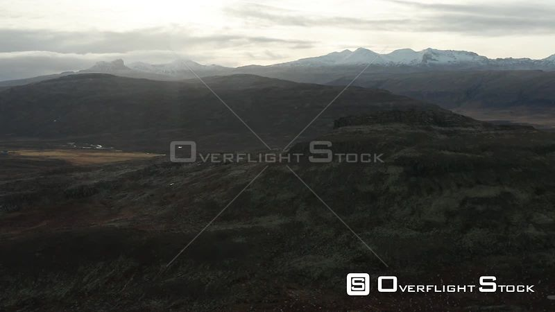 A Rise Over Mountains With Snowy Peaks Behind in Iceland.