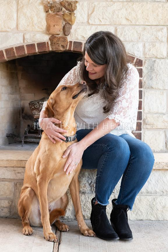 Woman and her dog lovingly looking at each other