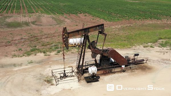 Oil well pump jack in operation, Robertson County, Texas, USA