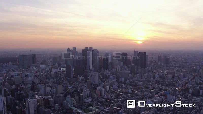 Japan Tokyo Aerial Flying over Shinjuku area with cityscape views at night