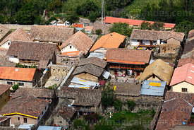 Aerial view of houses and rooftops in village of Ollantaytambo, Sacred Valley, Peru