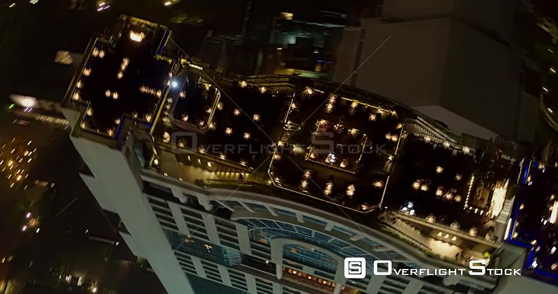 Thailand Bangkok Aerial High panning birdseye detail view of rooftop restaurant bar at night