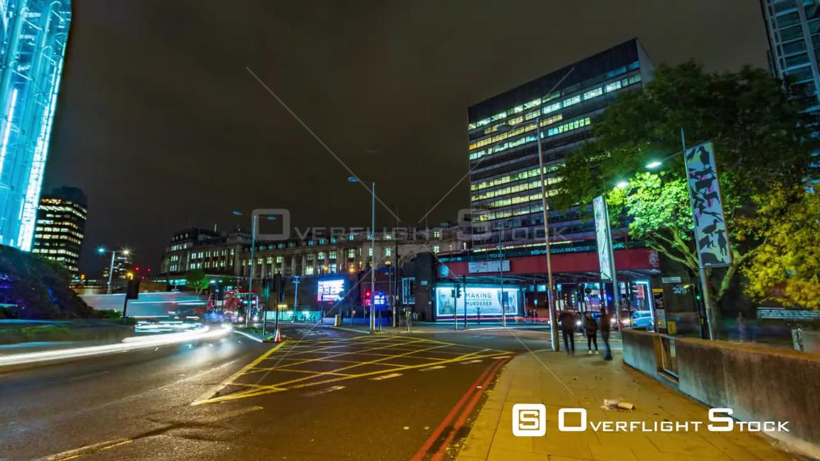 Timelapse view of a busy crossroad near Waterloo station in London at night