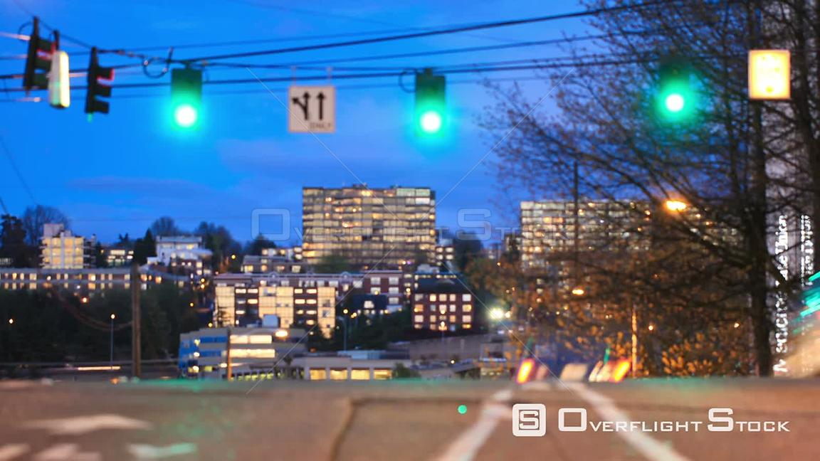City traffic time lapse of passing vehicles in the early evening. Seattle Washington