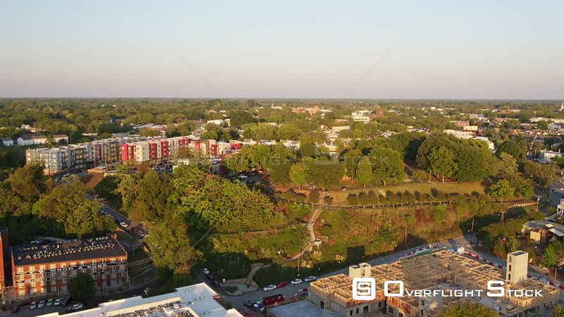 Richmond Virginia Aerial Panning birdseye of cityscape at sunset with park and downtown details