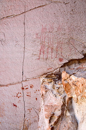 Detail of rock painting of human figures and symbols at Tomas Laq`A site,  near Villa Mar, Potosí Department, Bolivia
